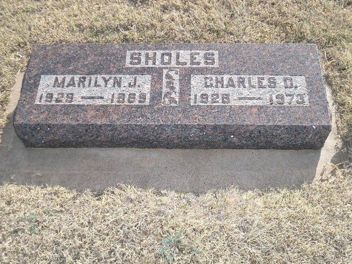 Charles D Sholes