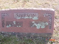 Laura E Simpson