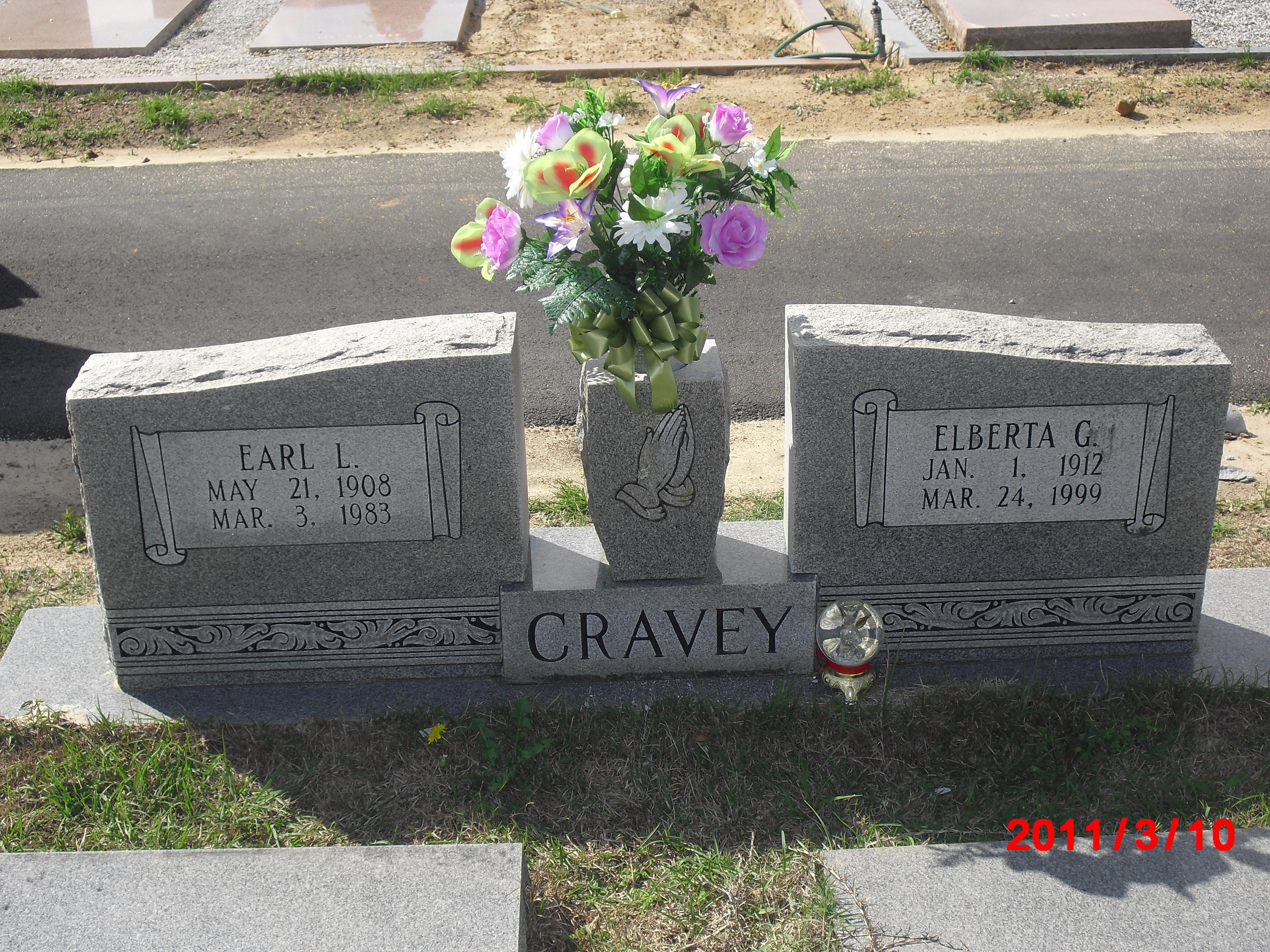 Earl L Cravey
